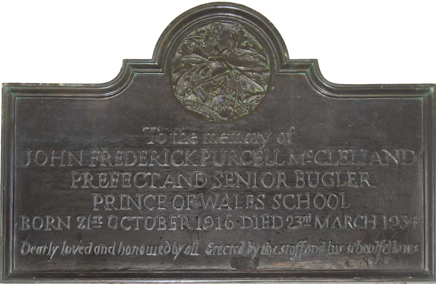The John McClelland memorial plaque in the cloisters of the Prince of Wales School/Nairobi School